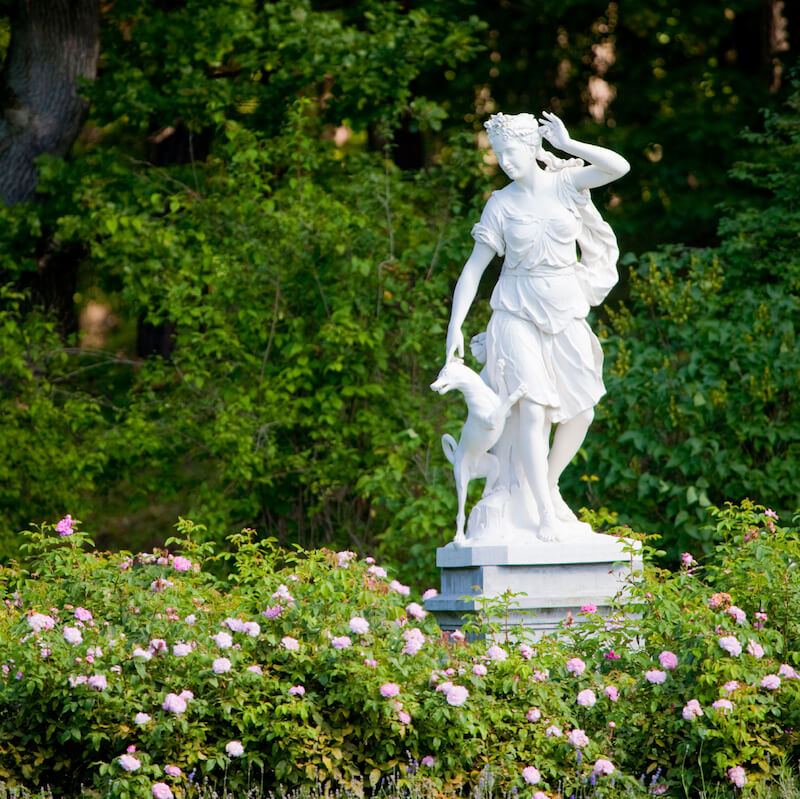 If you prefer a more classical design, Greek style statues can make a huge statement in a garden where most plants are much shorter than the statue.