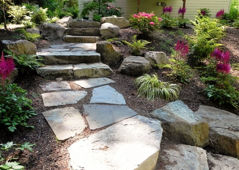 These stone steps are simple, but look very natural against the tropical landscaping.