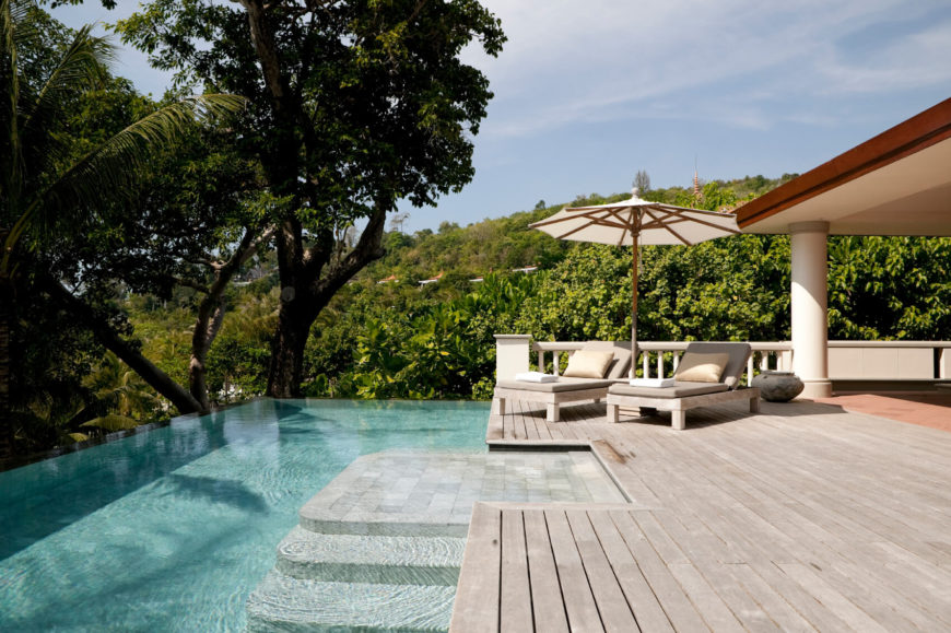 a beautiful infinity pool extends off of the ends of this deck with very little