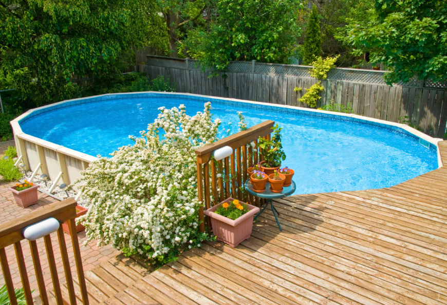 Above Ground Pool Ideas Backyard 25 finest designs of above ground swimming pool This Raised Deck Sits On The Far End Of An Oval Above Ground Pool
