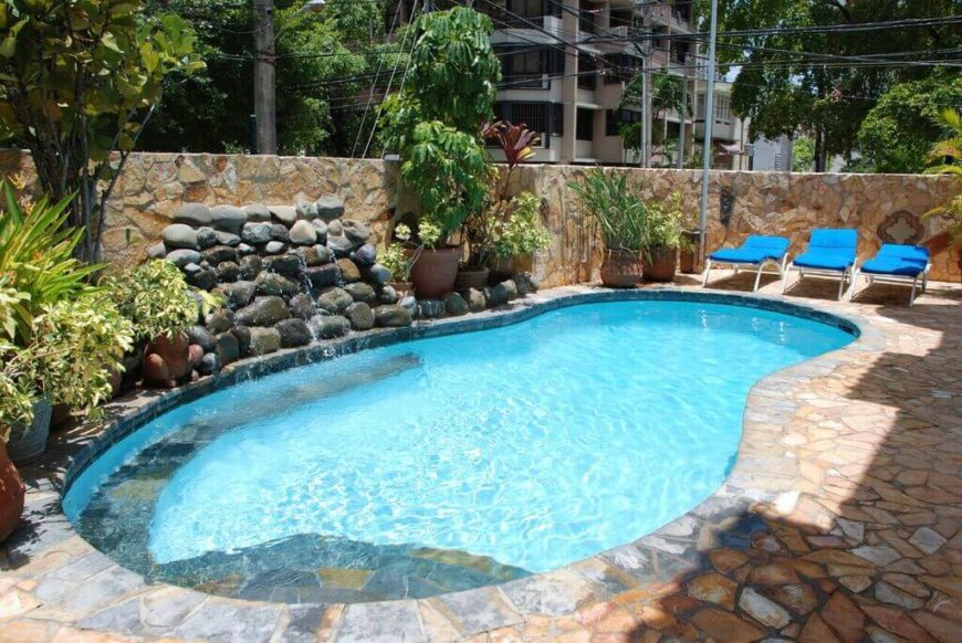This is a classic example of a small figure eight pool, with a nice stone