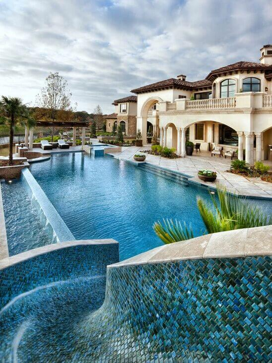 this beautiful pool slide is made from a lovely tile mosaic smoothed and with water