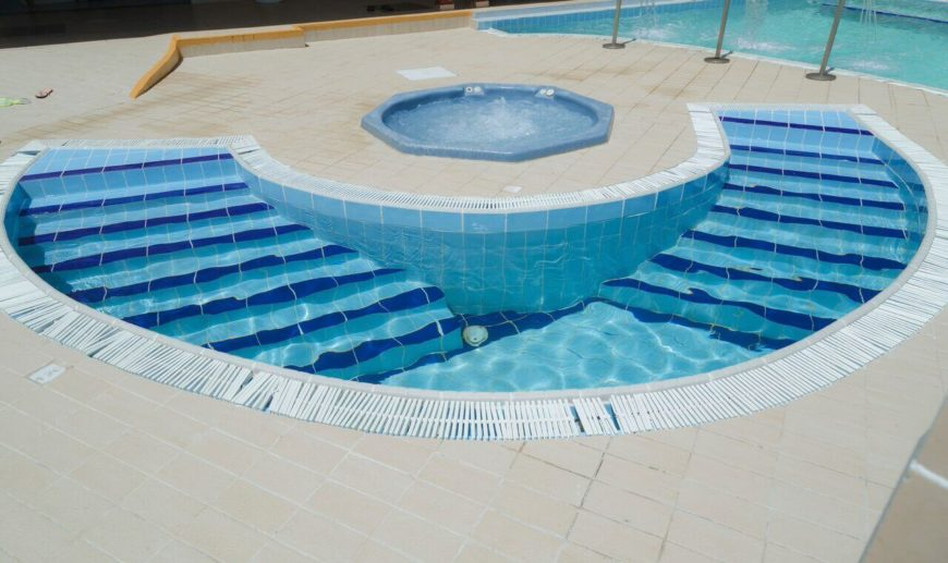 a perfect example of a plunge pool this half circle pool is right next to