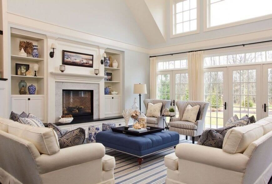 Marvelous Cottage Family Room Ideas Part - 4: This Cottage Home Uses Blue Well, Tying A Center Piece Ottoman Into The  Decorative Elements