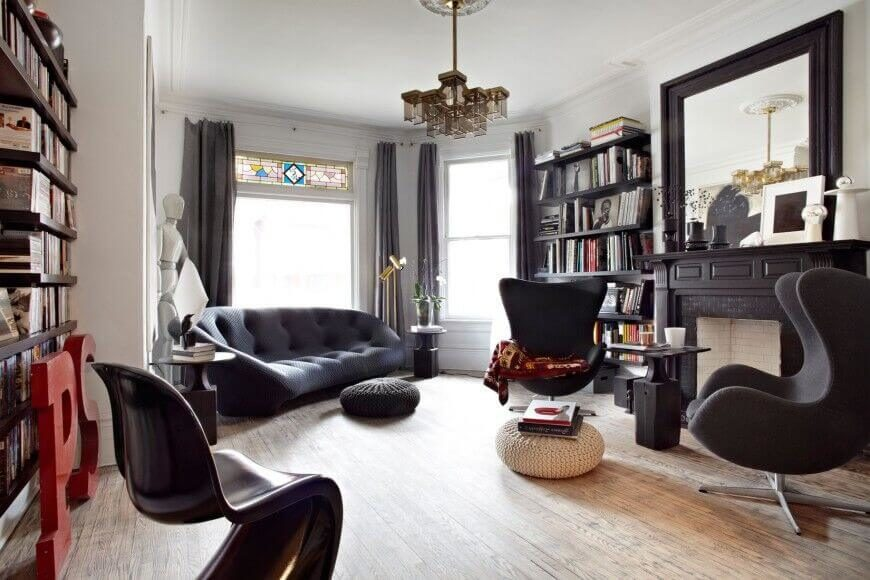 These Black Floating Shelves Match The Furniture And Hearth, Tying The Room  Together And Proving