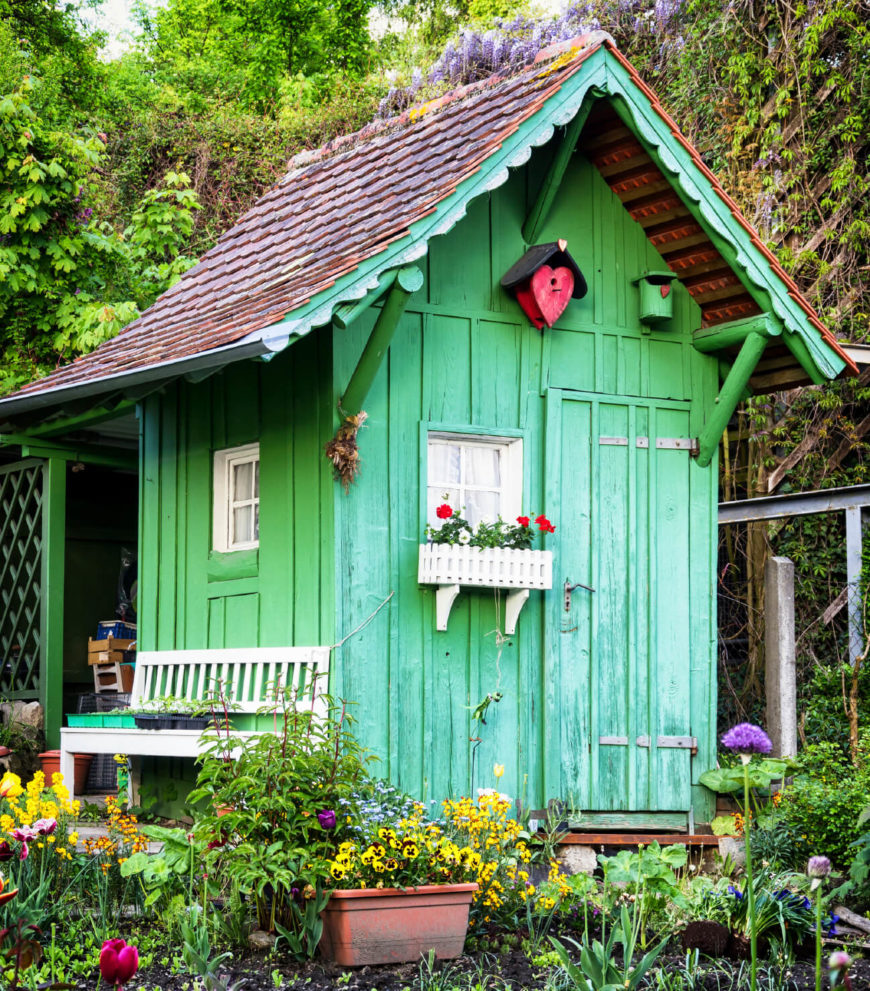 This Bright Spring Green Shed Has Adorable White Details And A Cedar Roof.  Tucked Into