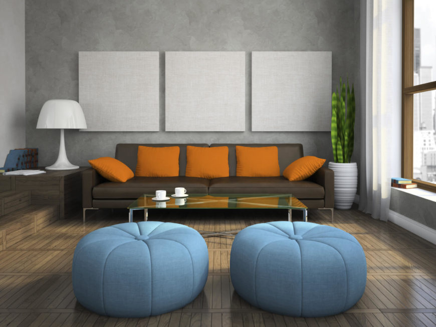 there are two round and interesting blue ottomans in this living room these pouf style