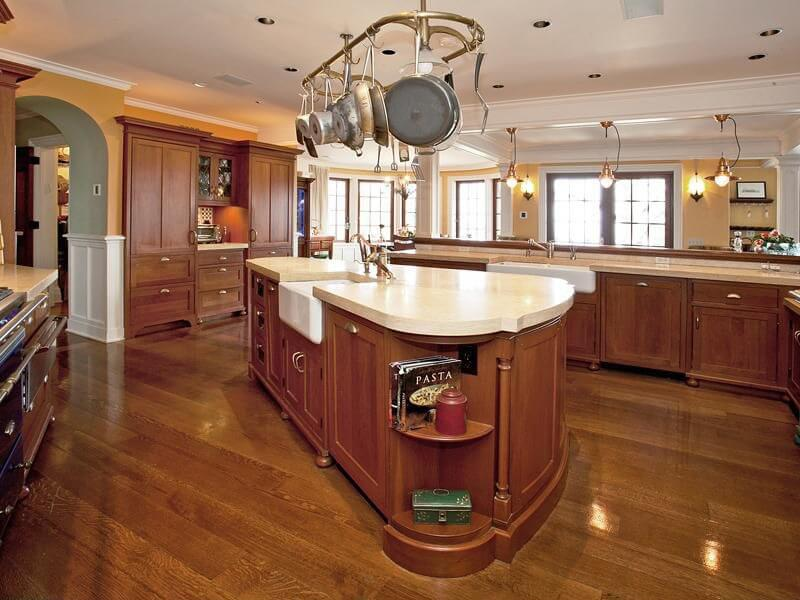 Solid Surface Countertops Prices : Pale solid surface countertops contrast with the rich wood throughout ...