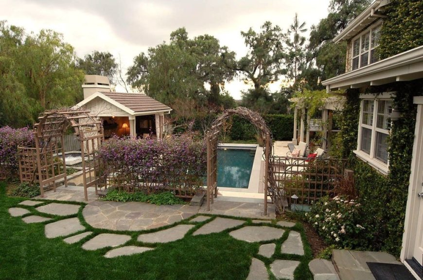 this beautiful vine covered home has two cedar arbors leading into the pool area - Arbor Designs Ideas