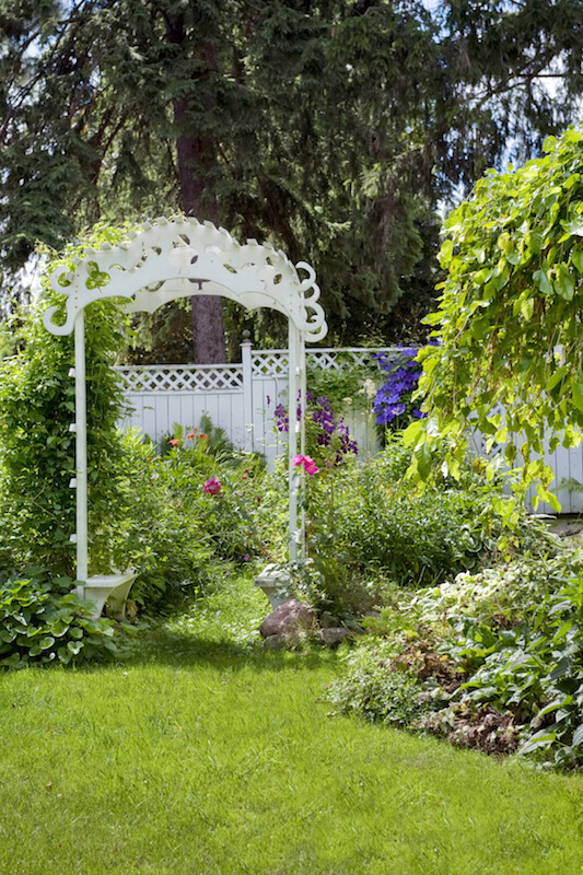 the incredibly ornate arbor has standard lattice sides but the top has a decidedly more - Arbor Designs Ideas