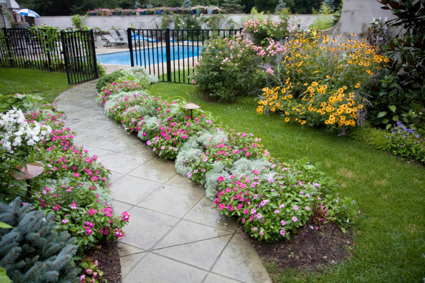 along the sides of a walkway is a great place for a line of flowers - Pictures Of Flower Bed Ideas