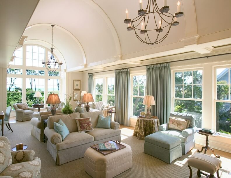 A Large And Luxurious Living Room Is Shown Here Under Bright Curved Vaulted Ceiling
