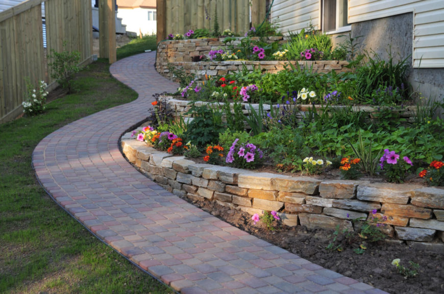 a stone garden bed looks great when paired with a stone walkway stones are a