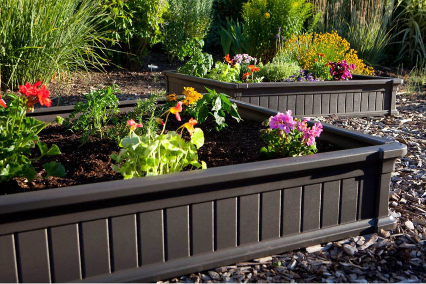 here are a couple of small black plastic raised flower beds that are stylish and simple - Planting Beds Design Ideas