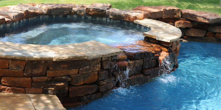 by lining your hot tub in stone or brick you can really incorporate it into the