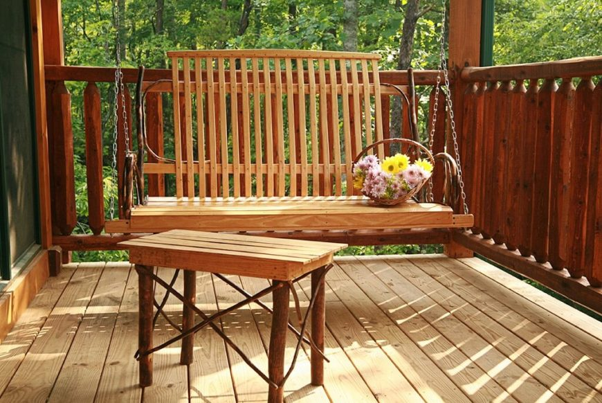 Backyard Swing Ideas recommended for you Rustic And Charming Wooden Porch Swing With A Matching Coffee Table