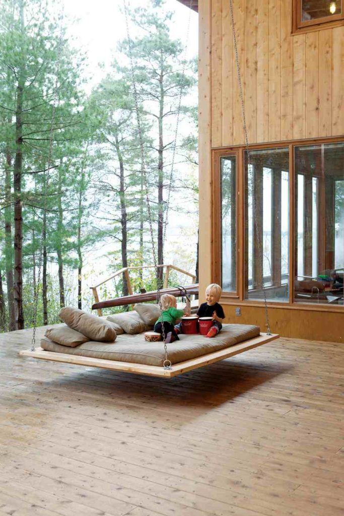 Backyard Swing Ideas pallet swing bench In This Picture There Is A Swing That Has Been Hung From A Porch Structure