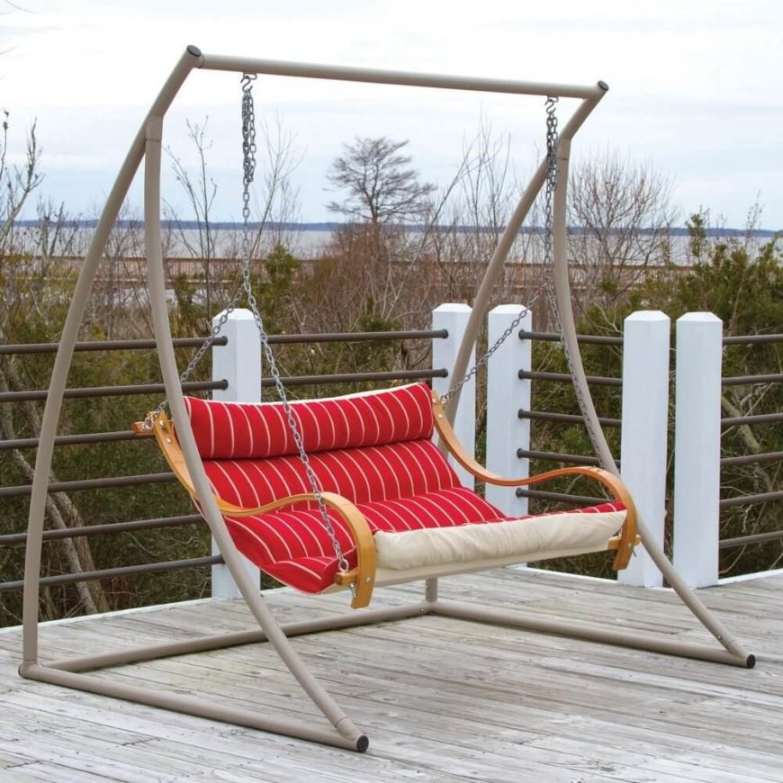 in this picture there is a sleek and simple yard swing that has a leaned