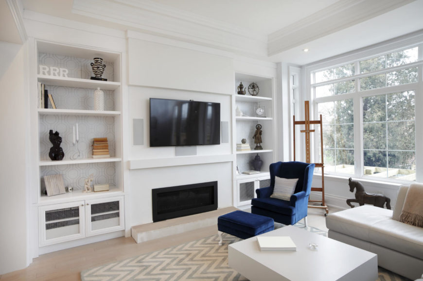 in a living room that uses a lot of white space using a few splashes - How To Add Color To A Room