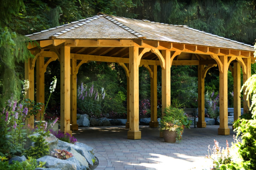 this pavilion is built with highly finished wood and has small stone