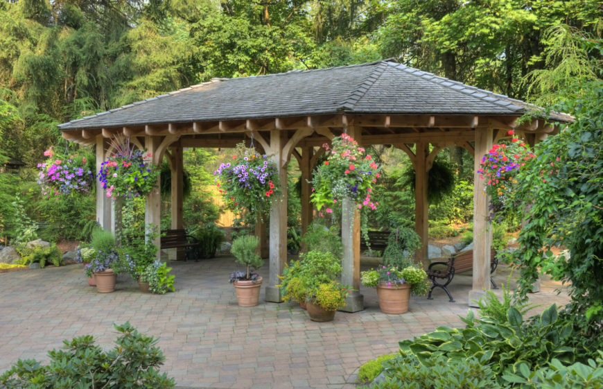 pavilions are the perfect companion to gardens hanging flowers on the outside of a pavilion - Patio Pavilion Ideas