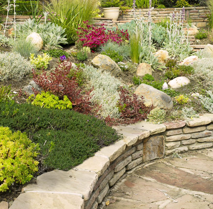 32 backyard rock garden ideas for Stone landscaping ideas