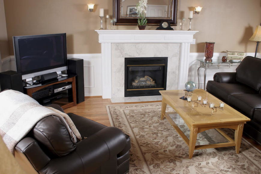 The Marble Face Of This Traditional Style Fireplace Directs The Eye To It As The Focal