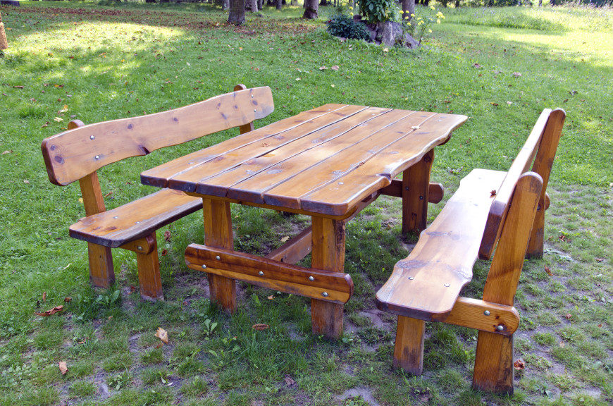 Here Is A Picnic Table With Separate Benches. The Wood Is Finished But Has A
