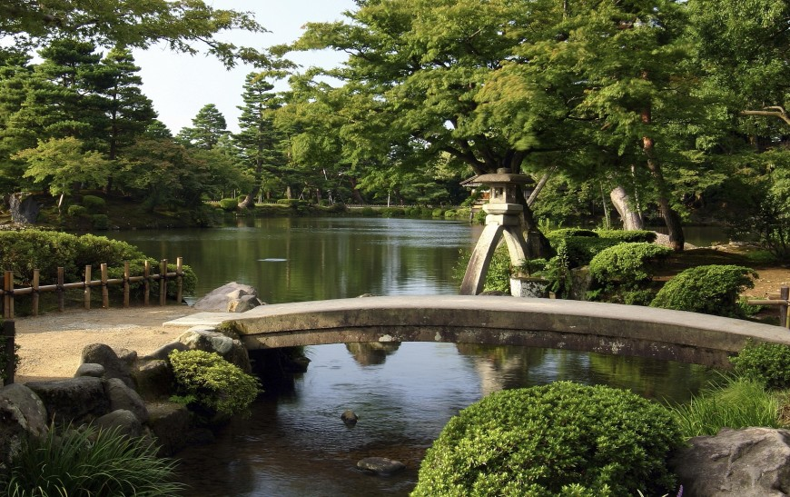 this walkway through a garden is a great example of a japanese inspired space the