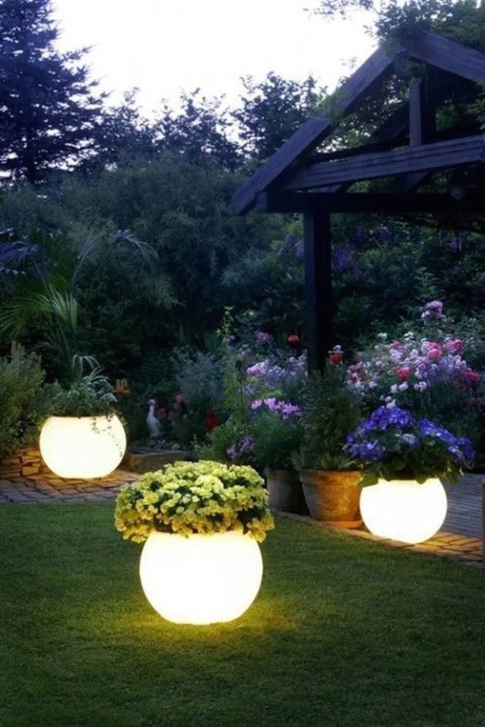 Here is an amazing and interesting idea. These planters have built in lights, making the potted plants lamps themselves! This is a beautiful idea that is sure to draw plenty of attention.