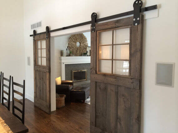 30 sliding barn door designs and ideas for the home for Sliding doors that look like french doors
