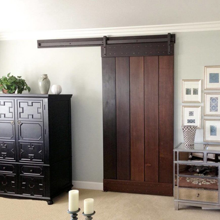 even a rich dark wood barn door looks great the hardware blends in beautifully with