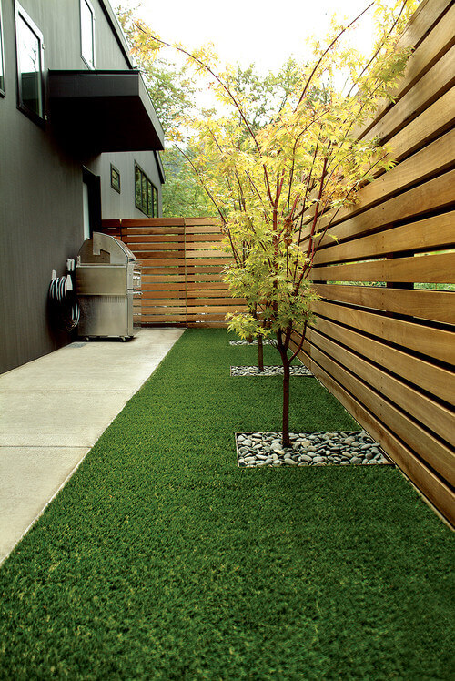 the small space between this fence has a nice piece of astroturf this is a contemporary landscape - Landscaping Design Ideas For Backyard