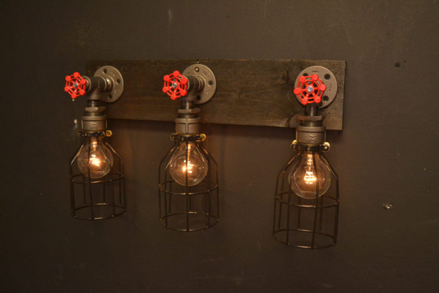 reclaimed industrial lighting. this series of three lights is perfect for a bathroom vanity featuring matching faucets reclaimed industrial lighting e