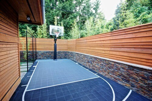 Backyard Sport Court Ideas green and blue backyard basketball court You May Be Surprised To Learn What Kinds Of Spaces Can Hold A Decent Basketball Court