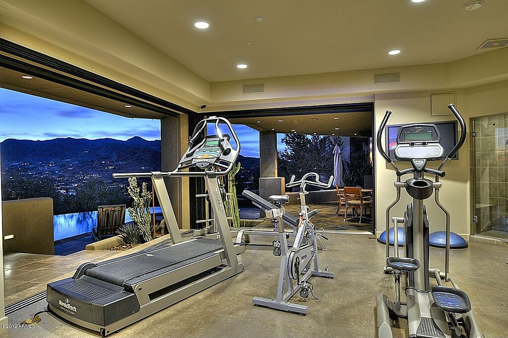 27 luxury home gym design ideas for fitness buffs for Luxury home gym