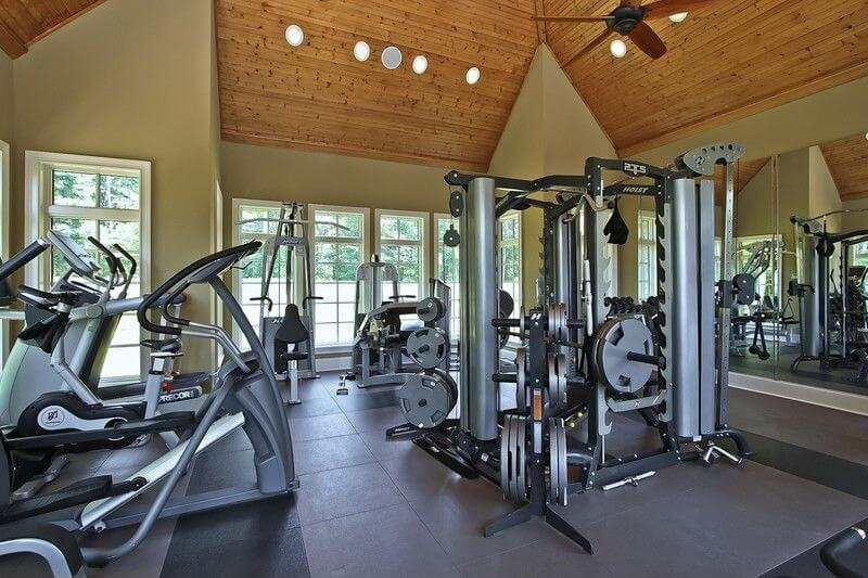 home gym with plenty of windows top of the line equipment and - Home Gym Design Ideas