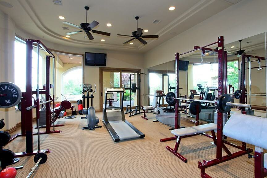 home gym with plenty of free weight equipment. beautiful ideas. Home Design Ideas