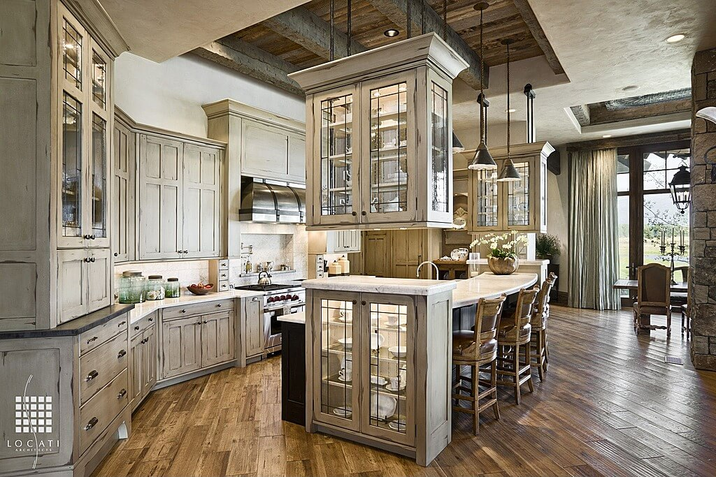 With Unique Kitchen Island Where One End Has A Hanging Glass Cabinet