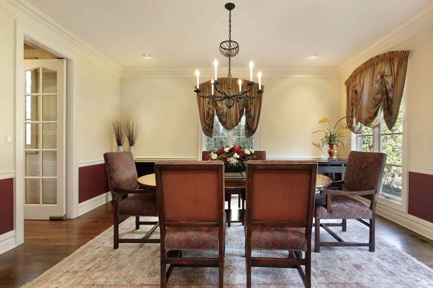 pale yellow dining room. simple yet effective dining room design with very light yellow and red all tied together pale k