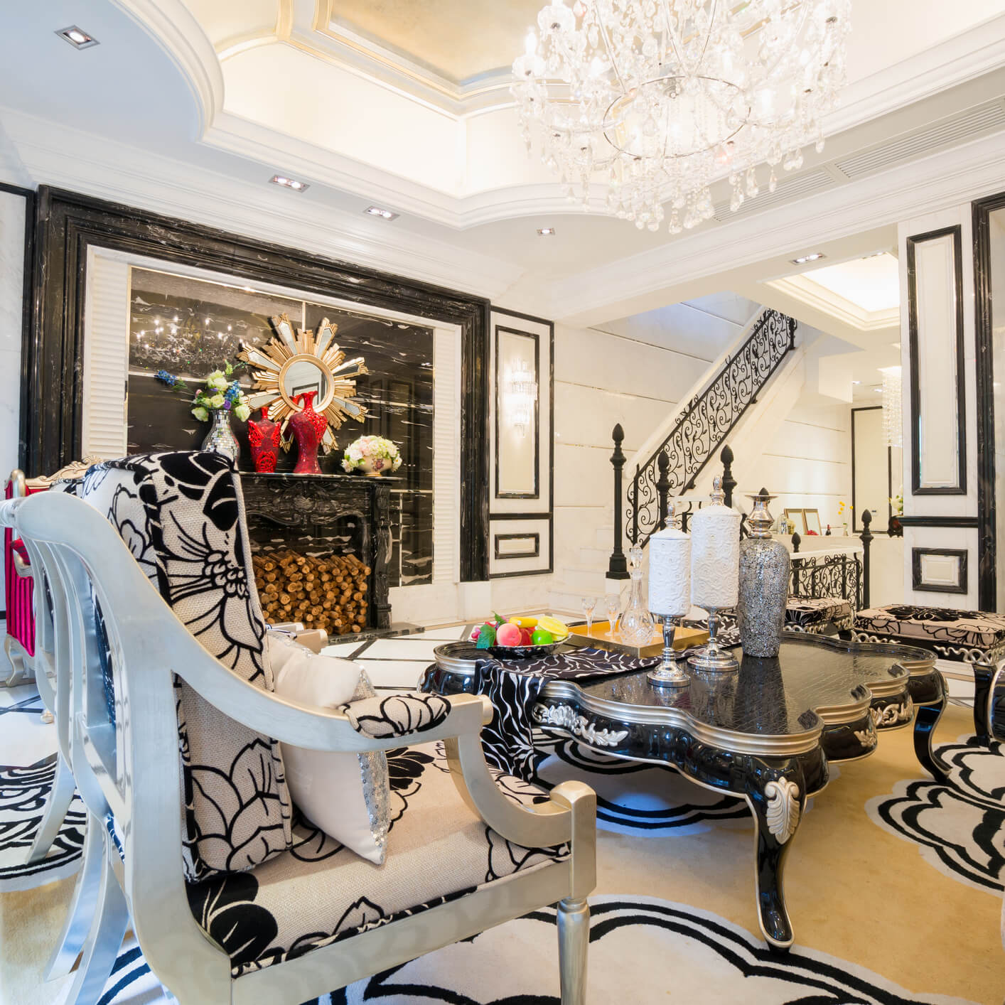 Zebra living room design with black and white patterns on the walls, staircase, floor, furniture and coffee table.