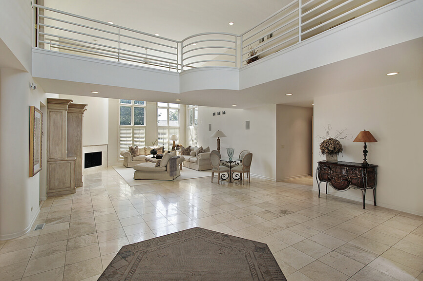 Example of a modern, spacious home with second floor landing extending above the living room.