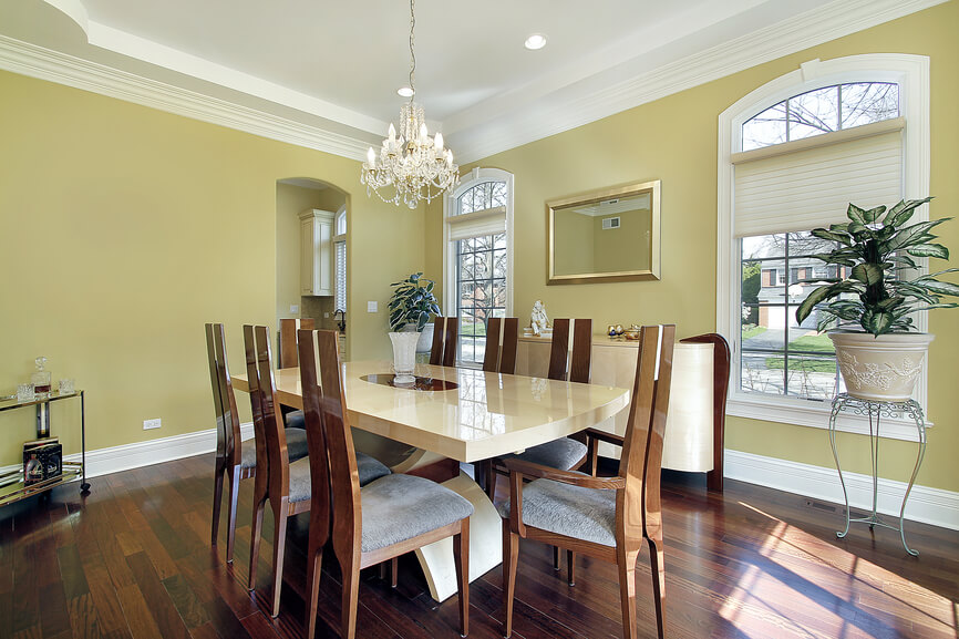 yellow and white dining room design with wood floor wood chairs and white dining table