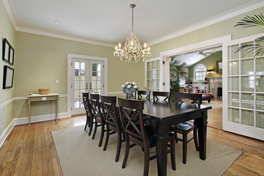 large home with light yellow and white dining room twotone