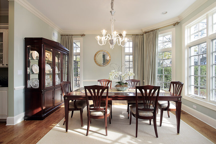Dining Room With Windows On Three Sides Of The Light Blue And White Color