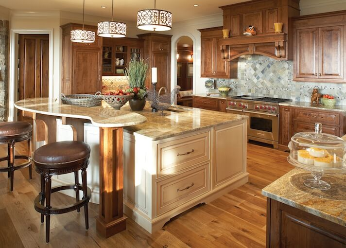 charming Large Kitchen Designs With Islands #8: White kitchen island in natural wood kitchen design. Island includes  adjacent elevated counter creating a