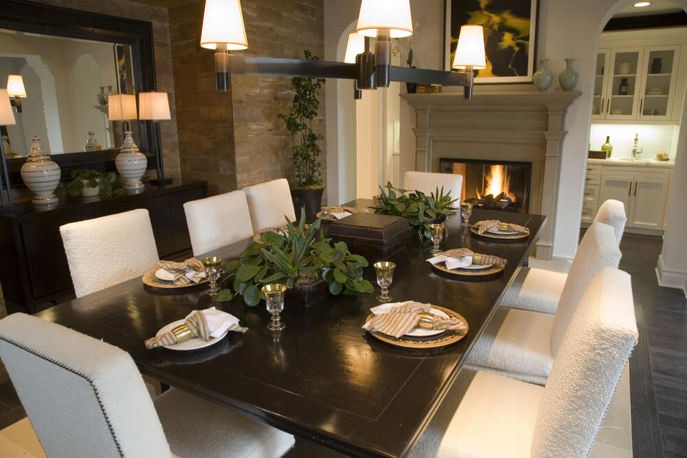 Dining Room With Brick Walls, Fireplace And Dark Wood Table With Eight  Dining Chairs.