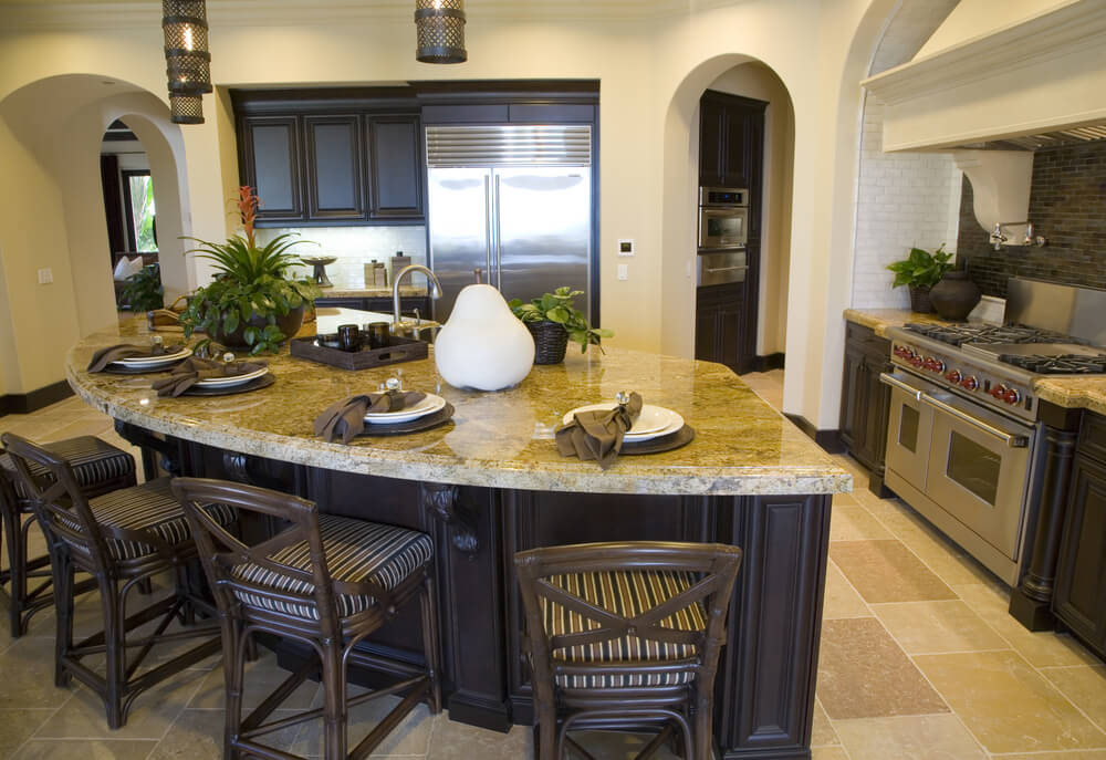 Mid-size kitchen with curved island.