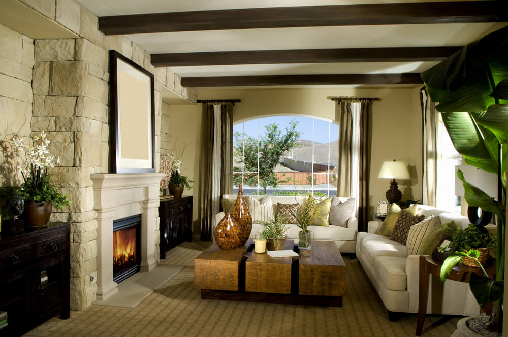 Contemporary living room design with stone fireplace, white mantle, carpeting, white sofas and beige carpeting.