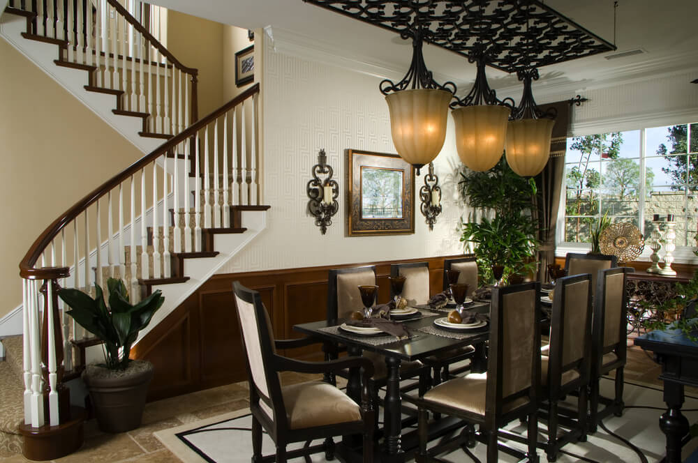 Dining Room Situated Beside Staircase With Half Landing